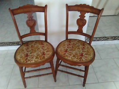 Matched Pair of Carved Antique Chairs