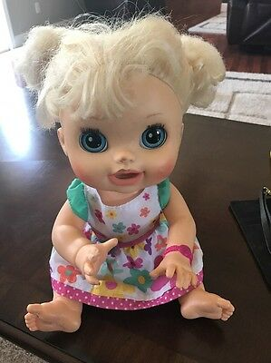 """Baby Alive 2012 """"Real Surprises"""" blonde doll with original dress works good"""