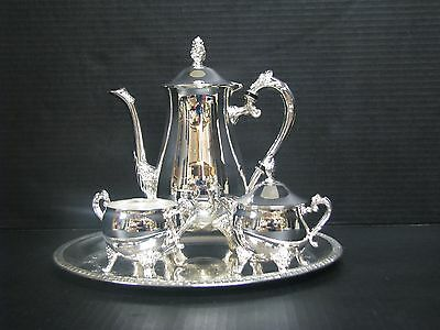 Elegance in Silver: Three Piece Coffee Set with Round Tray