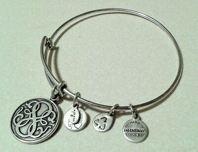 Alex and Ani with Charm sliver Bangle Bracelet pre owner.