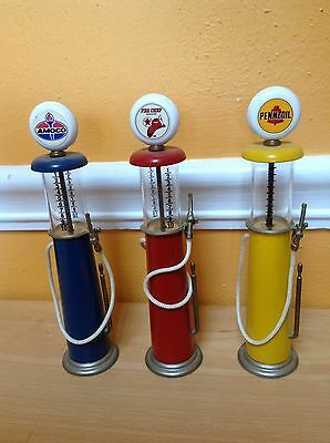 """Vintage Diecast and Glass Miniature Gas Pump Replicas 7 1/2"""" Lot Of 3"""