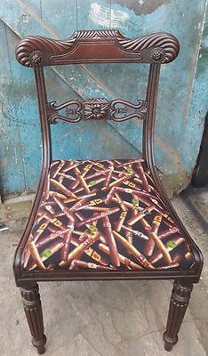 pair of antique decorative carved wooden hall chairs