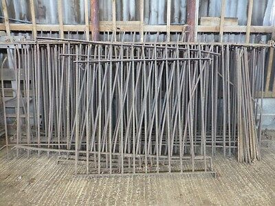 """Old wrought iron fencing panels 3'10""""H. 11 @ 9ft long. 1 @ 6ft long plus 3 bits."""