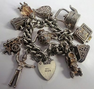 Amazing heavy vintage solid silver charm bracelet & large, opening silver charms