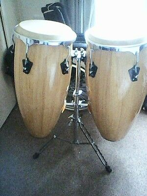 Two large handmade drums, in pretty good condition, with a wood finish. No brand