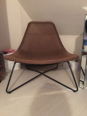 Price Reduction! Mid-century vintage rattan sling chair in excellent condition.