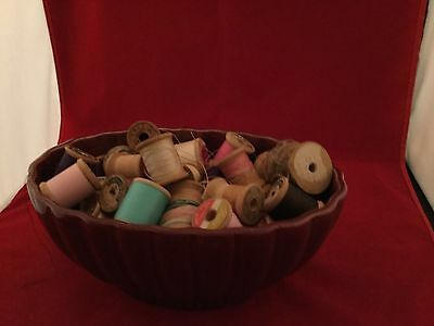 Vintage thread on wooden spools, there are 9 large spools, 22 Sml.spools,