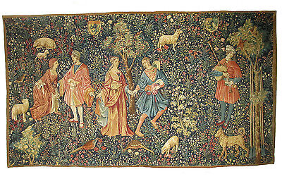 A Mille Fleur Style Tapestry with Shield, Dogs, and Pheasants