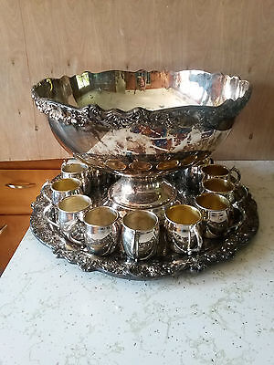F.B  Rogers Silver plate Punch Bowl with tray and 15 cups. Elegant styling.