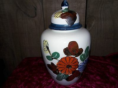 "Vintage 8"" tall jar with removable lid and dark floral design"