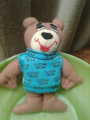 "post sugar crisp bear 4"" in height with shirt that has sugar crisp written on it"