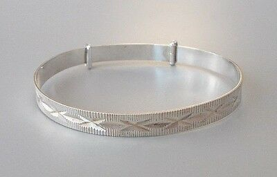 Contemporary sterling silver 5.5'' adjustable diamond cut christening bracelet