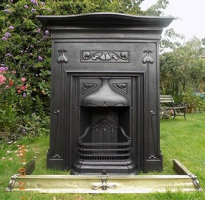 large & tall Art Nouveau cast iron fireplace dated c.1902 very pretty design.