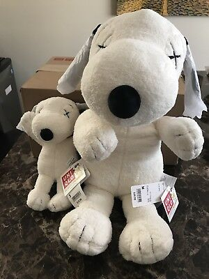 KAWS x PEANUTS UNIQLO SNOOPY PLUSH TOY SET OF 2 - 1 SMALL and 1 LARGE IN HAND