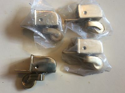 SET OF FOUR BRASS CUP CASTORS new unused comes with fixing screws