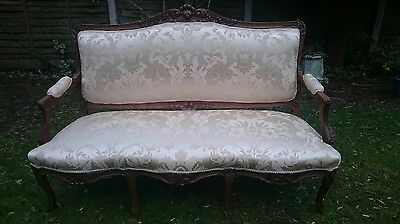 Antique French Carved walnut  sofa  reupholstered in beautiful buttermilk silk.