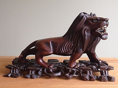 Antique Chinese large hand carved hard wooden lion figurine stand