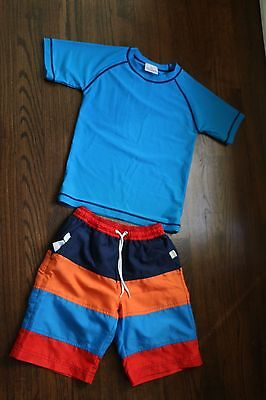 Hannah Anderson sz 120 blue,orange ,navy, red swim trunks & blue 130 swim shirt