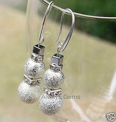 Stardust Snowman made with Swarovski crystals Earrings Nice silver plated hooks