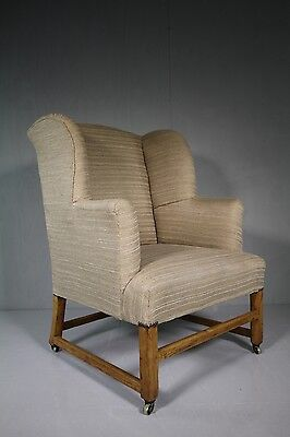 Large Georgian Antique Upholstered Wing Armchair.