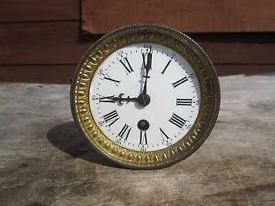 A French 7 Day  Mantel Clock With Its Dial Bezel Hands Rear Door And Straps
