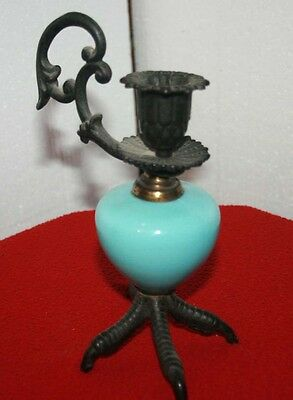 Victorian Claw Candle Holder.  Rare and in great condtion.  Turquoise Blue Glass