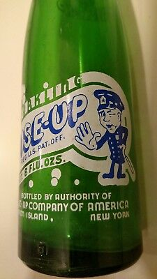 Wise Up picture of policeman ACL bottle 8 oz