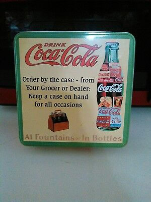 coca cola puzzle and tin container