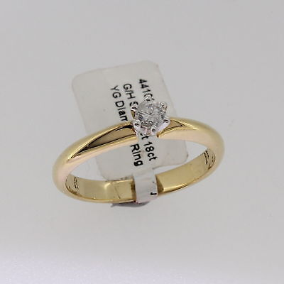 New unused 18K solid yellow gold natural diamond solitaire engagement ring