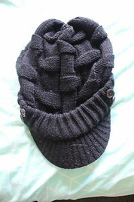Black beanie hat with peak. One Size fits all.