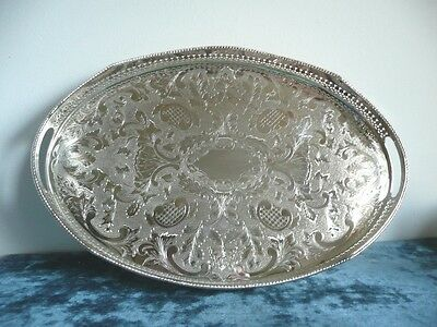 OVAL SILVER PLATED CHASED GALLERIED DRINKS TRAY 18 inches.