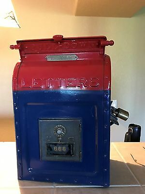 antique us mail box, manufactured in 1909, cast iron, side door W/lock,