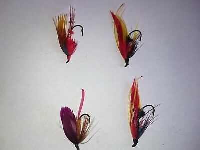 Dressed salmon flies x 4  nice hooks and vivid feathers size 3 and small size 6