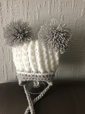 Baby's White/Silver crocheted  Double Pom Pom Hat sizes Newborn-12-24 mths