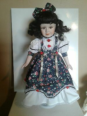 Seymour Mann Porcelain Doll black dress with red roses