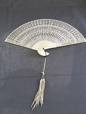 Antique Chinese brisse pierced fan with ribbon and tassle