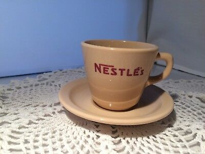 """Inca Ware """"nestle's"""" Cup And Saucer  (D004)"""