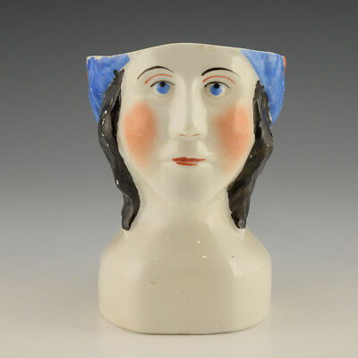 A Russian Kuznetsov porcelain mug of a woman with scarf