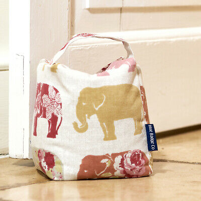 Large door stopper soft wheat filled carry handle in elephant by Blue Badge Co