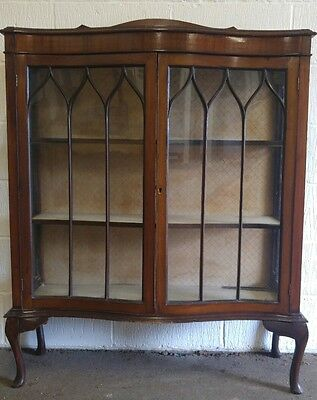 Serpentine display china cabinet on cabriole legs