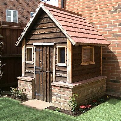 Decorative playhouse with a  brick plinth and tiled roof.