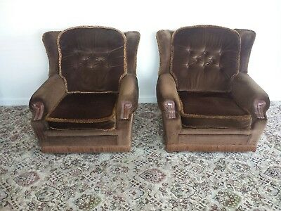 2 brown armchairs parker knoll material coverings with wood arm ends