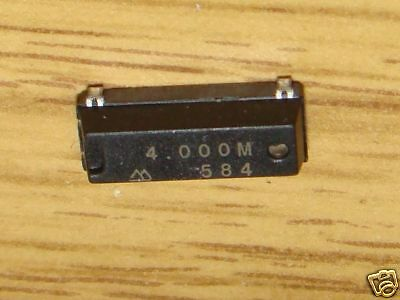 2 pcs 4 MHz Crystals. Type MA-406 by Seiko  7E3c