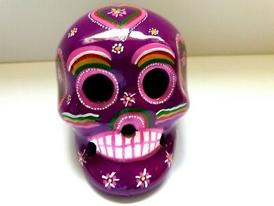 Cerámic skull ,(2Wx3Hx3L inches) purple color ,hand painted by jhf