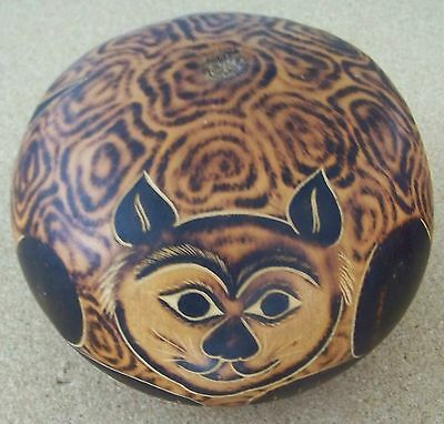 """Male Cat decorated and carved seed pod / gourd etched E Medina 6.5"""" diameter"""