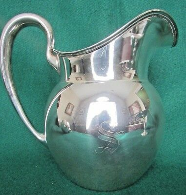 Sterling silver water pitcher by Weidlich Silver Co.