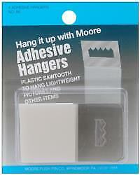 Moore Push-Pin Co. Adhesive Hangers For Pictures.