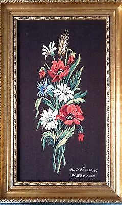 A Framed Tapestry with Flowers Signed Couturier
