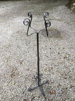 Flower Display Stand. Painted black, The four holding brackets are flexible.