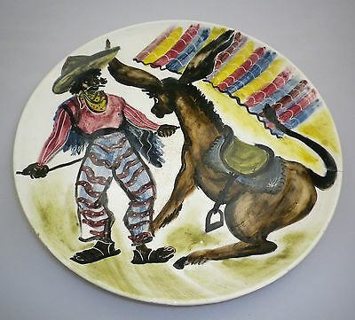 LARGE MARTIN BOYD HANDPAINTED PLATE DEPICTING A MEXICAN RESTRAINiNG HIS DONKEY